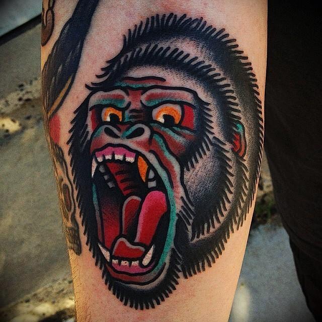 Furious colorcul gorilla head tattoo on arm