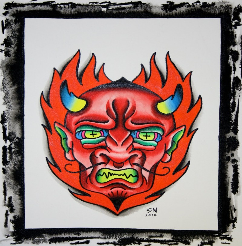 Furious devil face covered with flame tattoo design