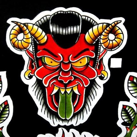 Furious red devil face with green tongue and aries horns tattoo design