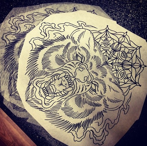Furious uncolored bear head on eyed mandala background tattoo design