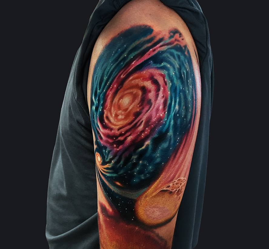 Galaxy tattoo on shoulder