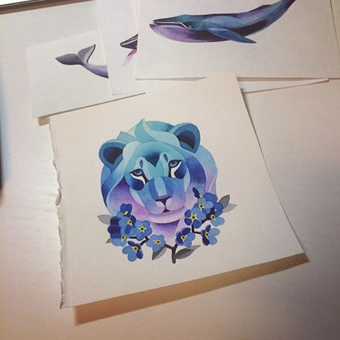 Geometric blue-and-purple lion and crossed flower branches tattoo design