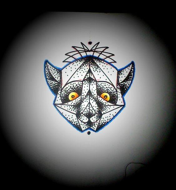 Geometric dotwork lemur head with orange eyes tattoo design