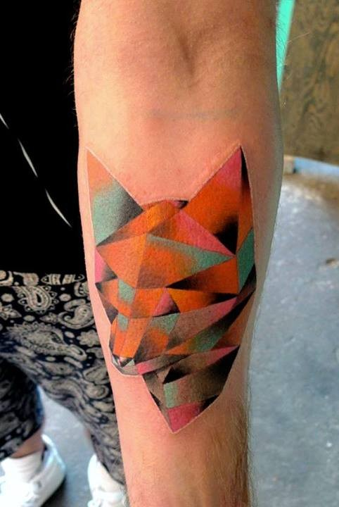Geometrical style colored forearm tattoo of fox head