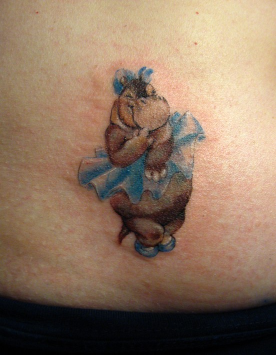 Girly colorful hippo in ballerina skirt tattoo on hip