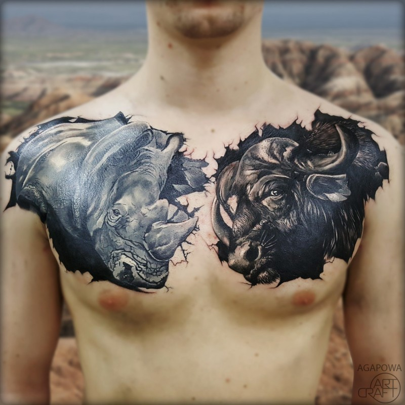 Graet rino and bull tattoos on chest