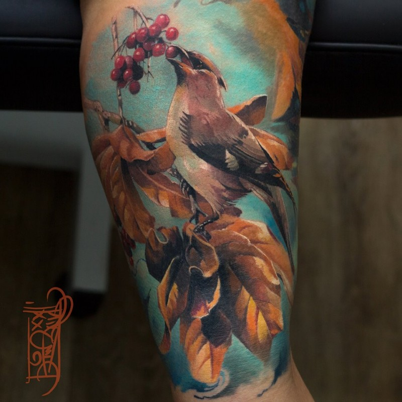 Great bird tattoo with golder leafs