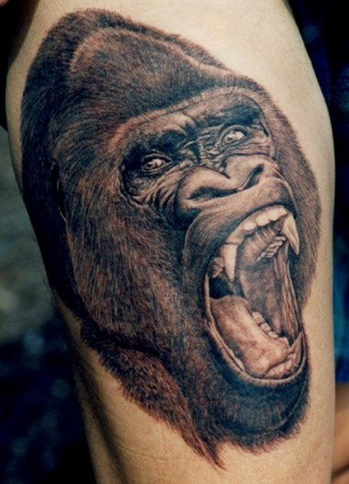 Great black-and-white gorilla head tattoo on thigh