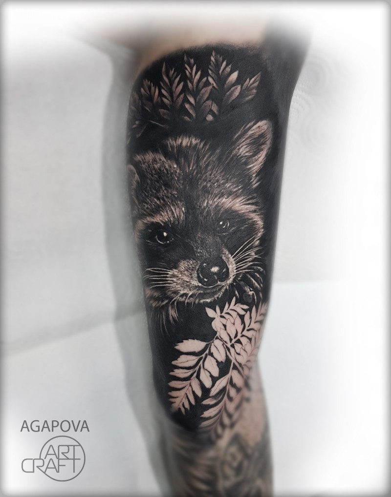 Great black and grey racoon tattoo on arm
