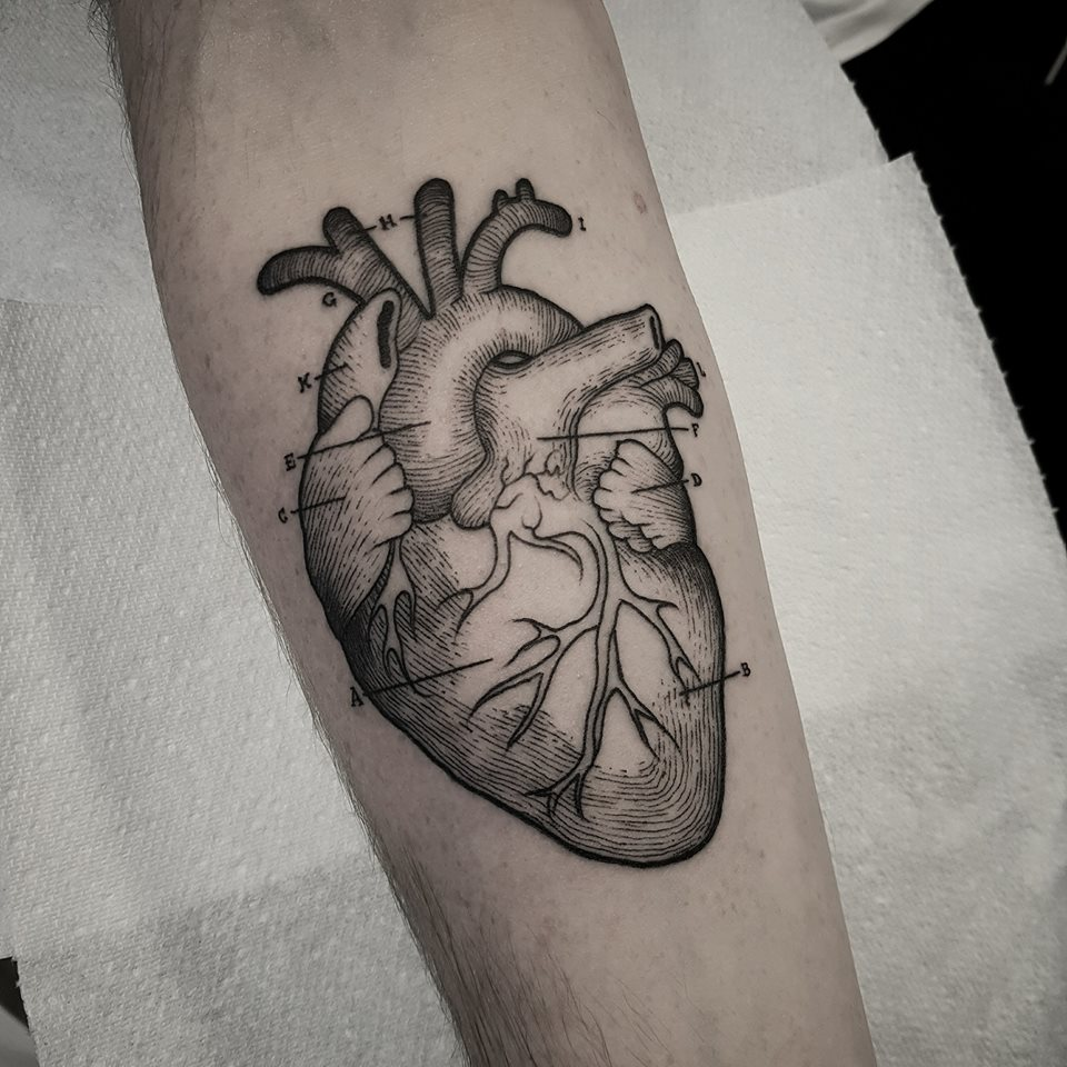 Great black and white linework heart tattoo