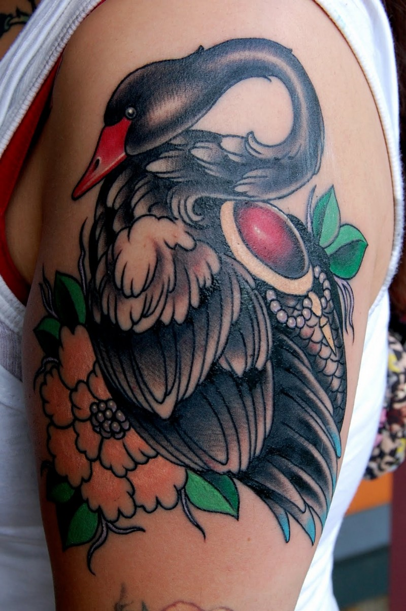 Great black swan with red jem and flower tattoo on upper arm