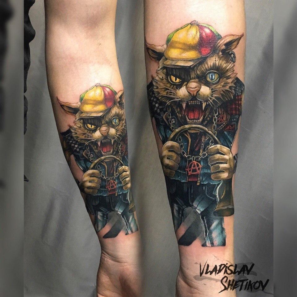 Great cartoon style cat tattoo on forearm