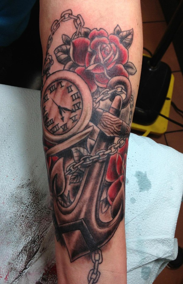 Great chained anchor with huge clock and roses tattoo for guys on forearm