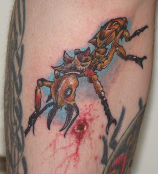 Great color-ink ant on blue background tattoo