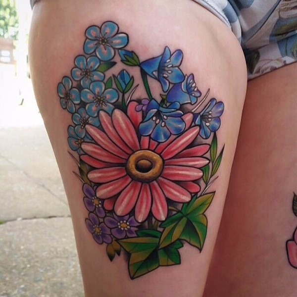 Great colorful daisy flower tattoo on thigh