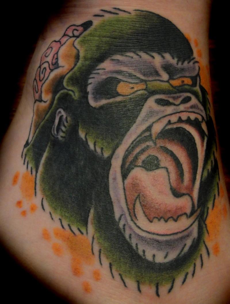 Great colorful gnarling gorilla head tattoo