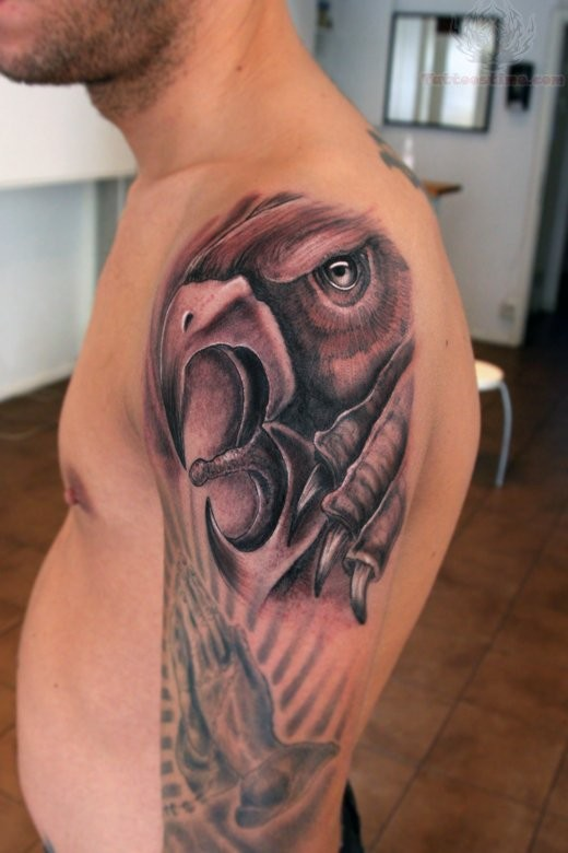 Great crying griffin tattoo for men on upper arm