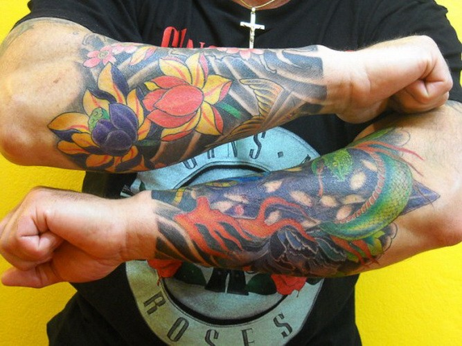 Great double japanese tattoo sleeves on forearms