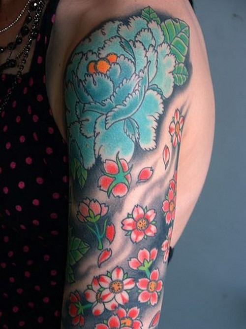 Great japanese flowers in black waves tattoo on arm