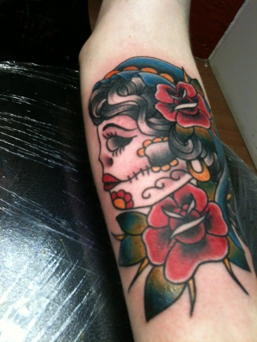 Great old school muerte girl tattoo for guys on forearm