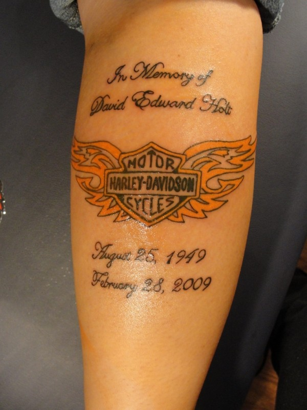 Great orange-winged blazon with quote tattoo on forearm