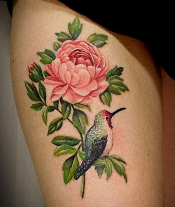Great pale pink peony flower with bird tattoo on thigh