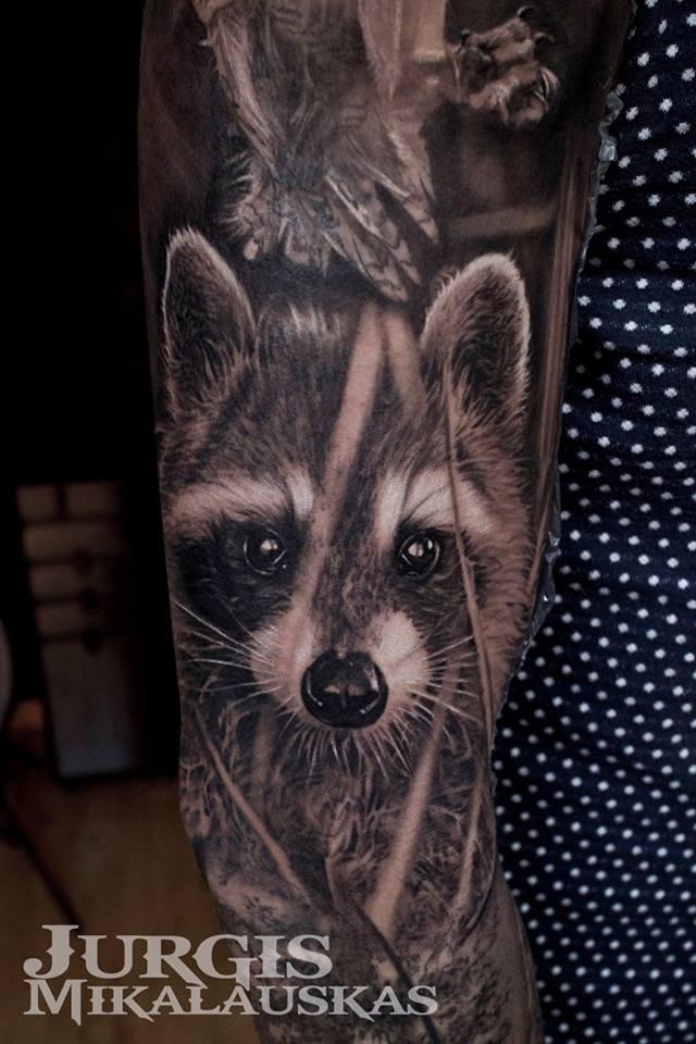 Great realistic racoon tattoo on sleeve