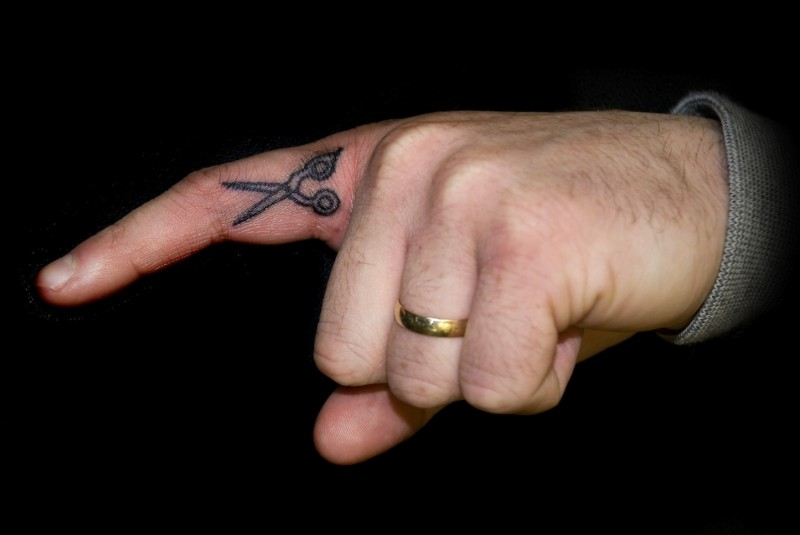 Great small black-ink scissors tattoo on finger
