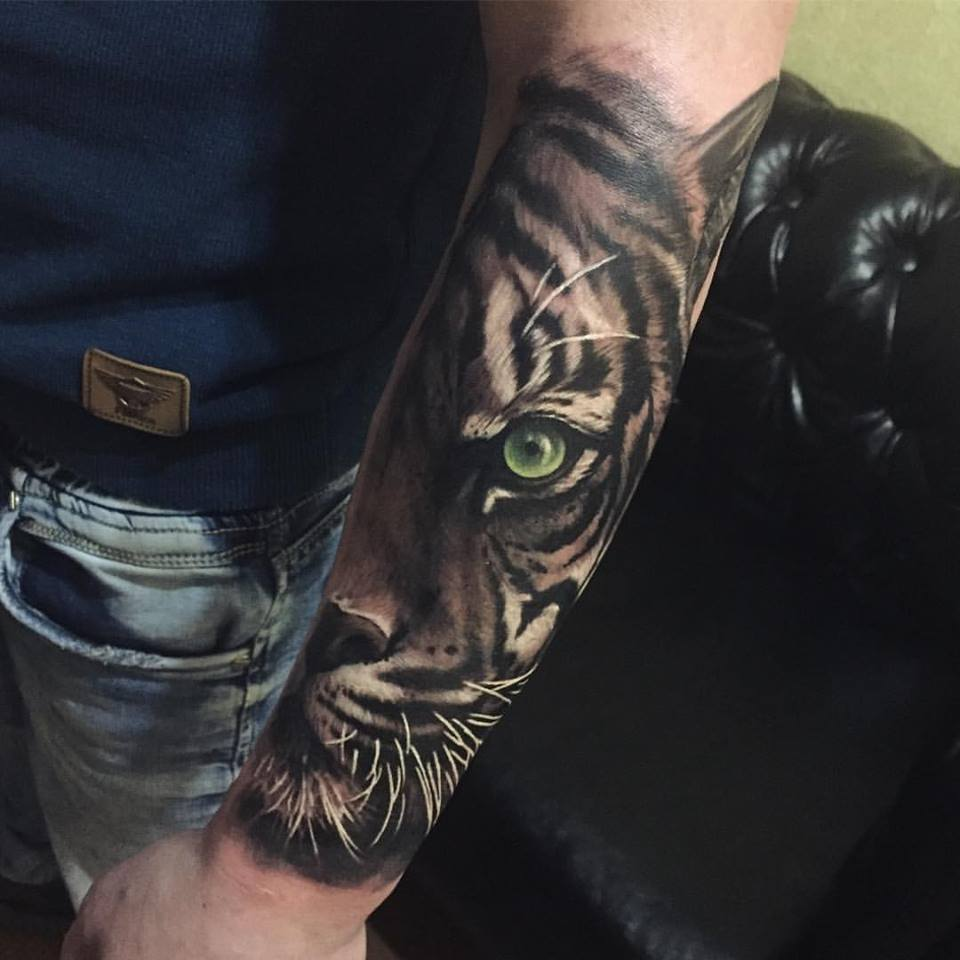 Great tiger head tattoo on forearm
