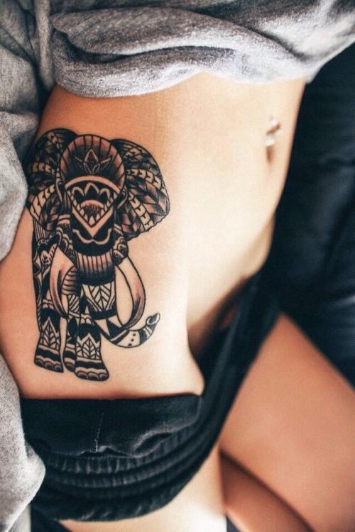 Great tribal black-ink mammoth tattoo on side