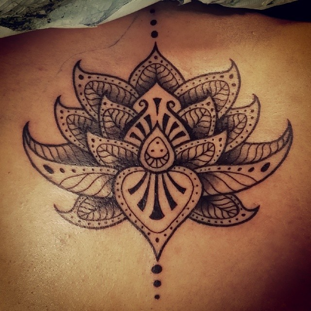 Great tribal lotus flower tattoo on back