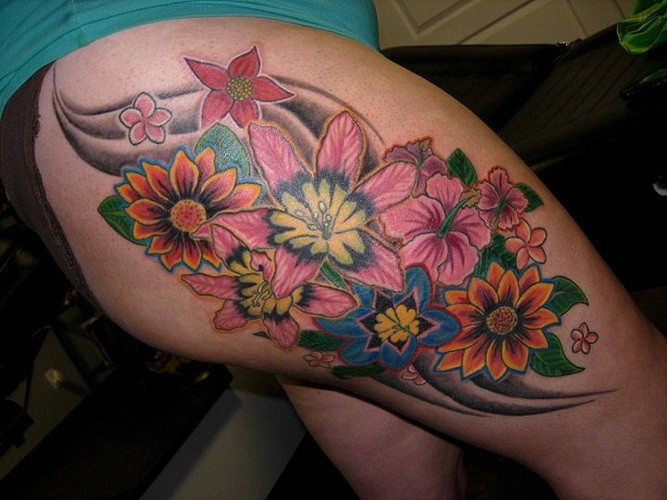 Great vivid colored flowers tattoo on thigh for Colorful thigh tattoos