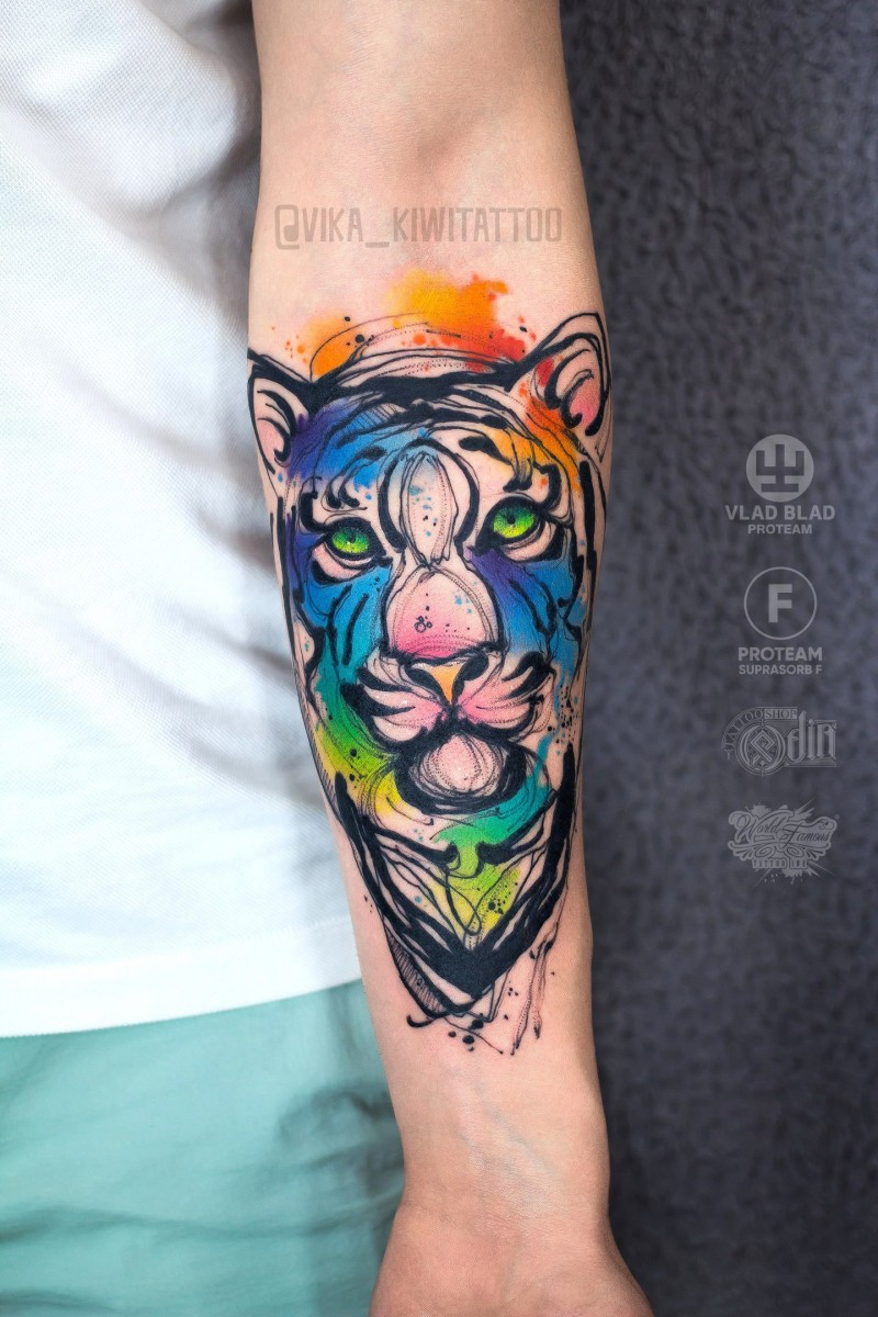Great watercolor tiger tattoo on wrist