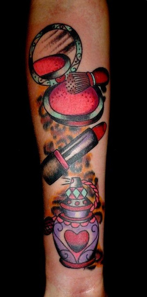 Great womens colorful cosmetics tattoo on forearm