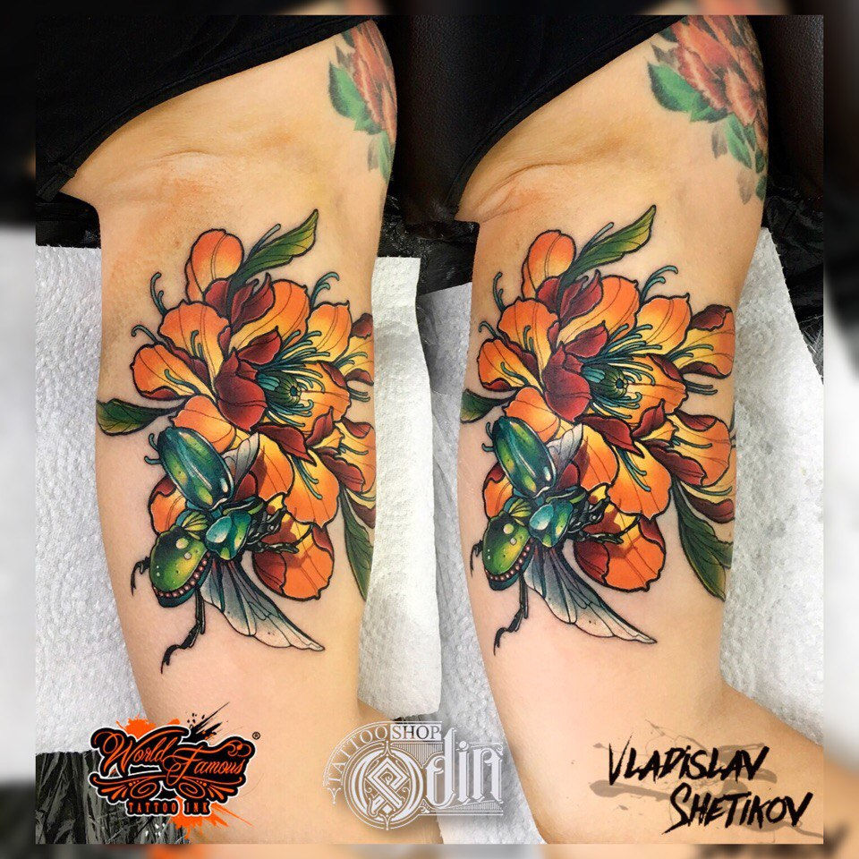 Great yellow flower and bug tattoo
