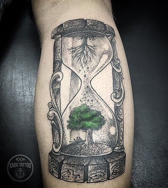 Green and black tree hourglass tattoo