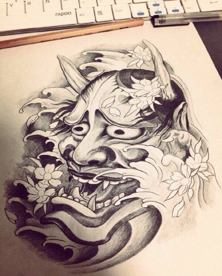 Grey-ink devil head wallowing in waves and cherry blossom tattoo design