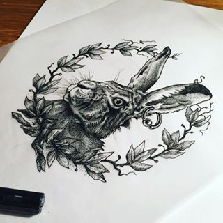 Grey-ink hare with piercing in ear in maple-leaf frame tattoo design
