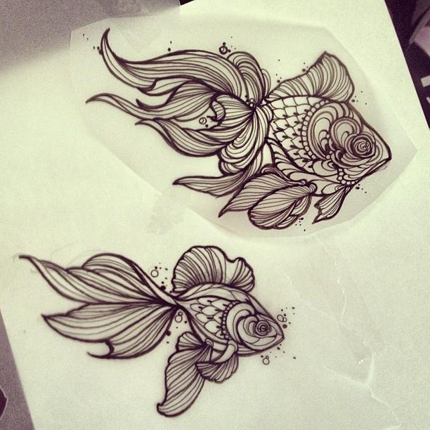 Grey-ink ornamented gold fish tattoo design
