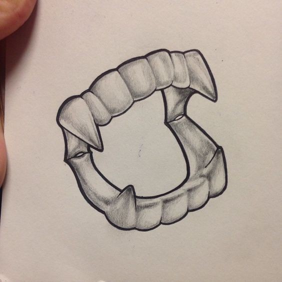 Grey-ink pencilwork vampire teeth tattoo design