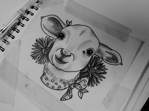 Grey-ink young sheep head with flowers tattoo design