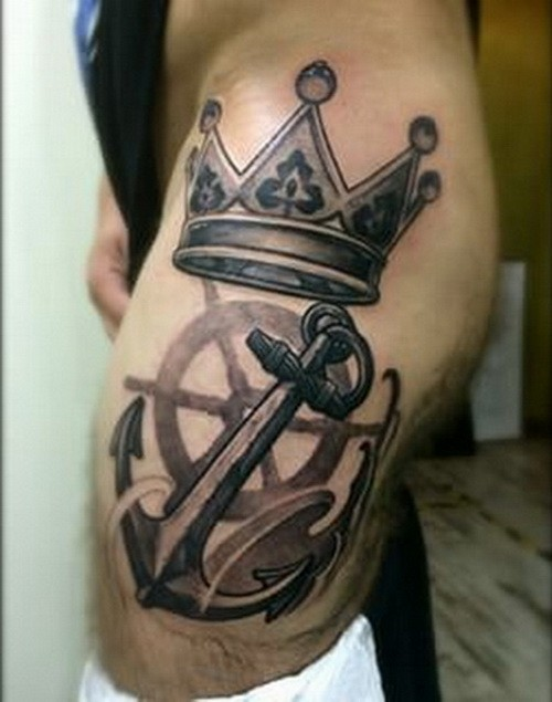 Harsh black-and-white anchor and crown tattoo on thigh