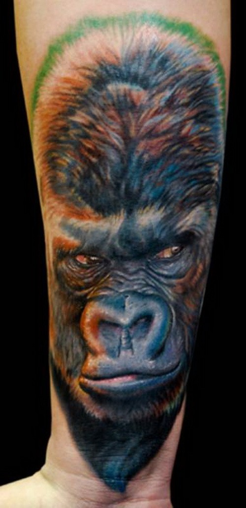 Harsh colorful gorilla head tattoo on arm