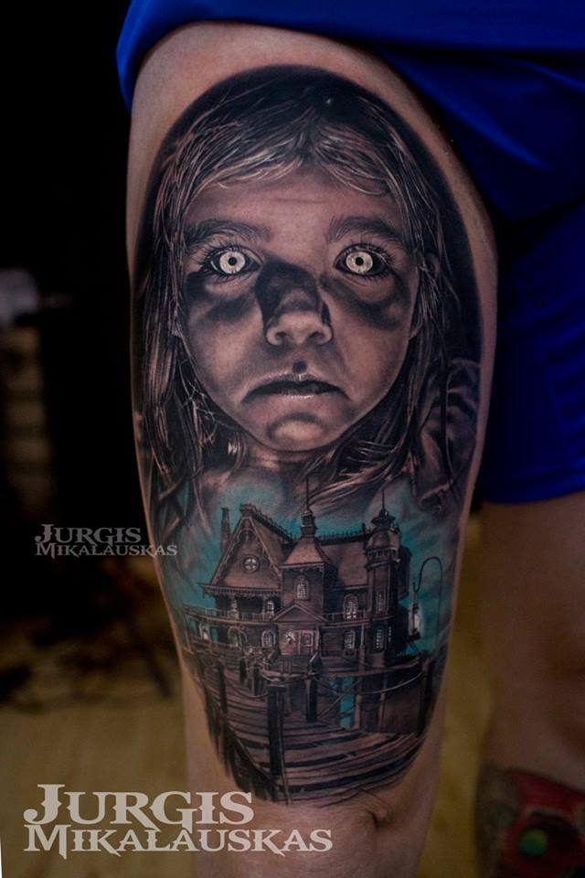 Horror girl and mansion tattoo on thigh
