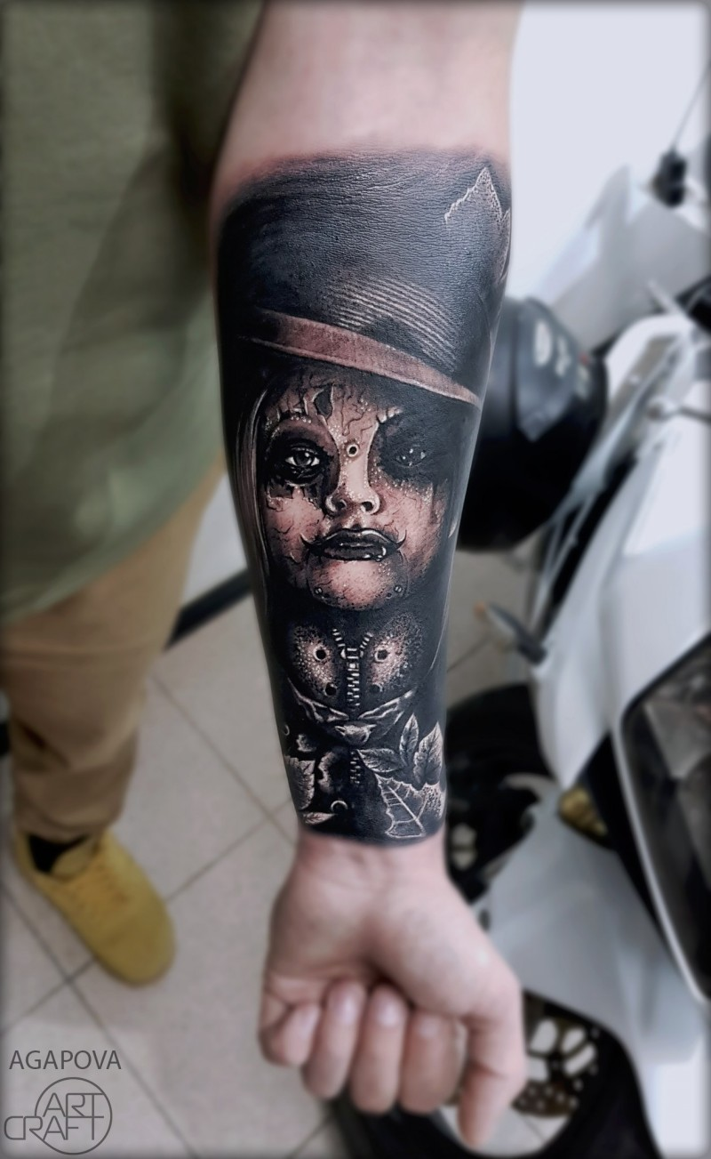 Horror girl tattoo on forearm