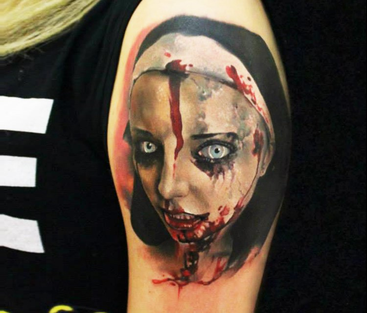 Horror movie style colored upper arm tattoo of bloody nurse