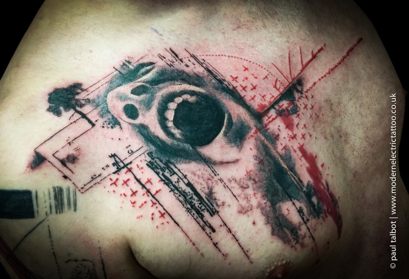 Horror style colored scapular tattoo of screaming face with lettering
