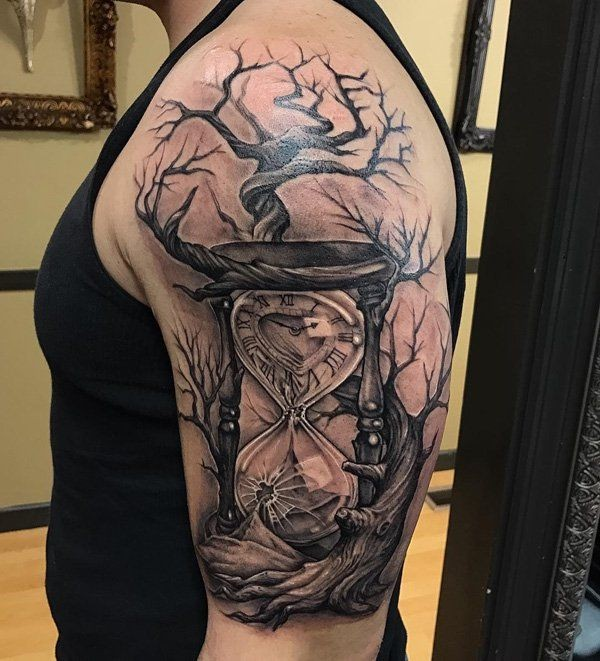 Hourglass and  tree of life tattoo on shoulder