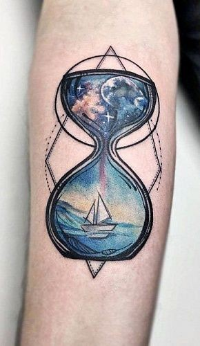 Hourglass space and sea forearm tattoo
