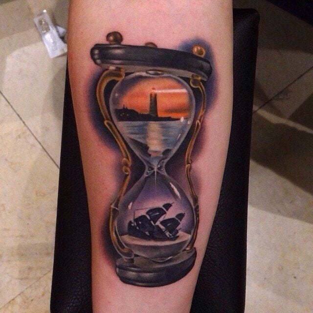 Hourglass with lighthouse and sunken ship tattoo